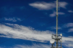 Communication tower radio mast with antenna aerial Royalty Free Stock Photos