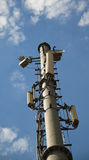 Communication tower. Radio,tv,internet communication tower in blue sky background Royalty Free Stock Images