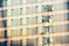Communication tower, Reflect from  glass building Stock Photography