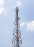 Communication tower with satellite dishes Royalty Free Stock Images