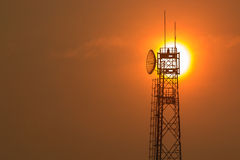 Communication tower at sunrise Royalty Free Stock Images