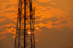 A Communication tower during sunset Stock Image