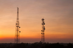 Communication Tower on Sunset background Stock Images