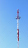 Communication Tower. Telecommunications/cell phone tower on a vibrant clear blue sky royalty free stock photo