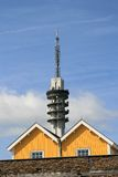 Communication tower and wooden houses Stock Photography