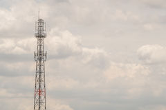 Communication towers in the sky dark at the half. Royalty Free Stock Photos