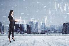 Communication and trade concept. Young businesswoman on rooftop using laptop with forex chart and night city view. Communication and trade concept. Double royalty free stock photos