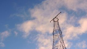 Communication transmit cell radio electrical tower with clouds stock footage