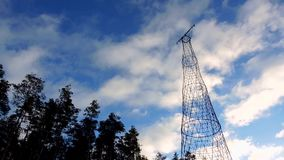 Communication transmit cell radio electrical tower with clouds stock video footage