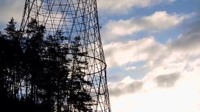 Communication transmit cell radio electrical tower with clouds. And sky 1 stock video footage