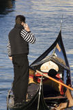 Communication in Venice. Gondolier on Cell Phone Stock Photo