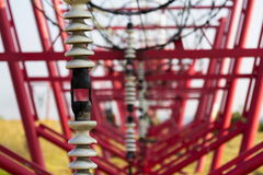 Communication wires lead to switching station from radio transmitter tower Stock Image