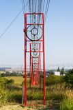 Communication wires lead to switching station from radio transmitter tower Stock Photography