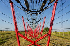 Communication wires lead to switching station from radio transmitter tower Royalty Free Stock Photo