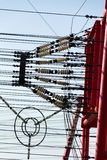 Communication wires lead to switching station from radio transmitter tower Stock Photo