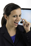 Communication: Woman talking on a headset Royalty Free Stock Photography