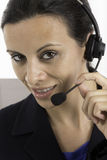 Communication: Woman talking on a headset Stock Image