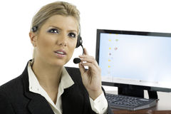 Communication: Woman talking on a headset Royalty Free Stock Images