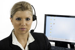 Communication: Woman talking on a headset Royalty Free Stock Image