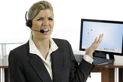 Communication: Woman talking on a headset Stock Photos