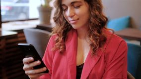 Communication woman texting chatting mobile phone. Communication and social networks. Woman texting or chatting on mobile phone in cafe stock footage