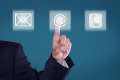 Communication. Young business man presses button Royalty Free Stock Photos