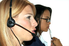 Communications. Business women team at work with headset and glasses Stock Image