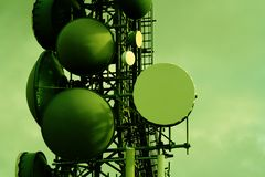 Communications. A close up on a communications tower in cross processed green Royalty Free Stock Photography