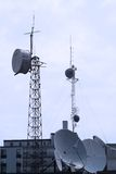 Communications. Radio Communications towers and dishes close to a TV Station Stock Photo