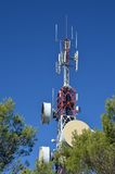 Communications antenna. With receptors and emitters for radio, television and telephony stock photography