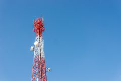 Communications antenna on blue sky Stock Images