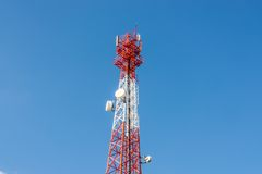 Communications antenna on blue sky Royalty Free Stock Image
