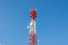 Communications antenna on blue sky Royalty Free Stock Image