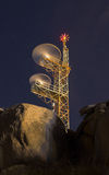Communications antenna at night Royalty Free Stock Images