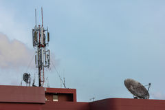 Communications and cell phone tower Stock Photos