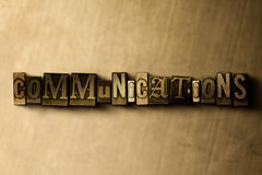 COMMUNICATIONS - close-up of grungy vintage typeset word on metal backdrop Stock Photography