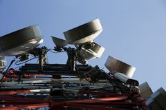 Communications dish on tower. Communications equipment on high tech tower Royalty Free Stock Photo