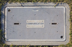 Communications infrastructure. Cover for underground communications infrastructure stock photography