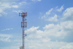 Communications mast. In a cloudy sky in morning time Royalty Free Stock Photography