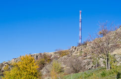 Communications mast on a hilltop Stock Photography