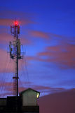 Communications Mobile Phone Radio Tower. In twilight royalty free stock photography