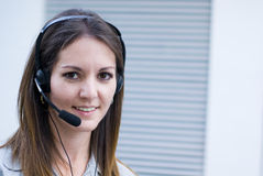 Communications professional. Happy profesional woman with headset stock images