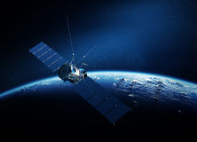 Communications satellite orbiting earth Stock Photos