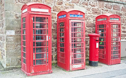 Communications. In three red telephone boxes and one snail mail box seen in Fort George on 9th August 2014 at ' through the centuries ' historic event Royalty Free Stock Photos