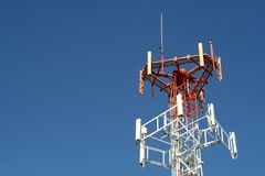 Communications Tower. A communications tower against a clear blue sky Royalty Free Stock Images