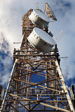 Communications tower. With electronic satellite transmitters Stock Image