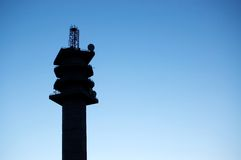 Communications tower. Silhouette of communication radio tower Royalty Free Stock Photography