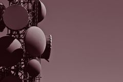 Communications tower. A burgundy duo tone photograph of a communications tower Stock Images