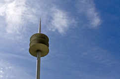 Communications Tower. Silhouetted against a cloudy sky Royalty Free Stock Photography