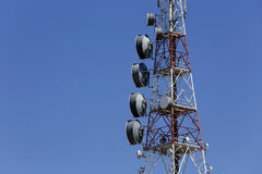 Communications tower. A communications tower with different antennas against the blue sky Royalty Free Stock Photo